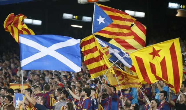 Catalunya s separatist supporters wave Esteladas Catalan separatist flags supporting Scotland s independence during FC Barcelona s Champions League soccer match against Apoel Nicosia at Camp Nou stadium in Barcelona September 17 2014 The referendum on Scottish independence will take place on September 18 when Scotland will vote whether or not to end the 307-year-old union with the rest of the United Kingdom REUTERS Albert Gea SPAIN - Tags POLITICS SPORT SOCCER